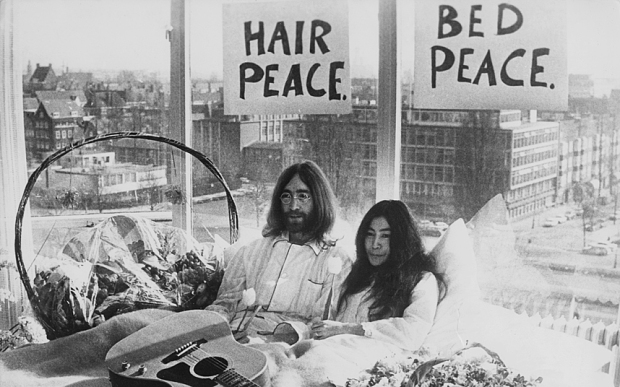 Beatle John Lennon (1940 � 1980) and his wife of a week Yoko Ono in their bed in the Presidential Suite of the Hilton Hotel, Amsterdam, 25th March 1969. The couple are staging a 'bed-in for peace' and intend to stay in bed for seven days 'as a protest against war and violence in the world'. (Photo by Keystone/Hulton Archive/Getty Images)