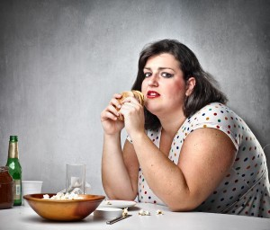 bigstock-Fat-woman-feeling-guilty-while-21341984-300x256
