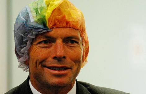 Tony Abbott wears a rainbow hair net as part of an organ donation campaign.